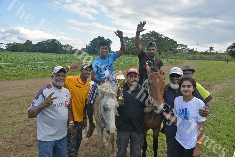 Horse owner and jockey Zinal Rahiman (right) with his horses Don and Ravoravo ridden by Ajnesh Chand pose for a photo with his family after finishing the Cross Country Race in first and second position respectively at the Sabeto Races in Nadi yesterday. Picture: REINAL CHAND