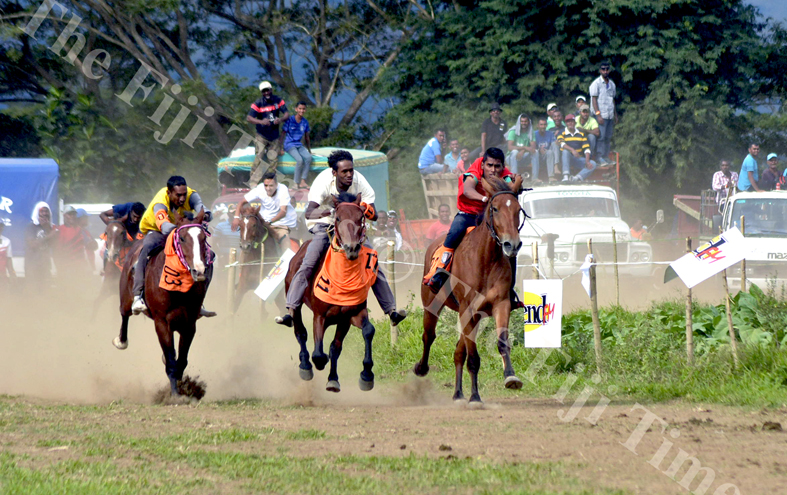 Jockey Luke Buadromo (centre) rides the horse SODELPA to victory in the Fiji Times Local Horse 1500m Race at the Sabeto Races in Nadi. Picture: REINAL CHAND