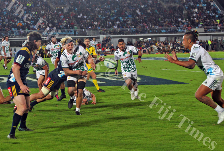 Mitch Karpik of Gallagher Chiefs offloads in the defence of Pulse Energy Highlanders players during their Super Rugby match at the ANZ Stadium in Suva on Saturday, June 30, 2018. Picture: JONACANI LALAKOBAU