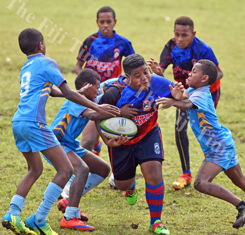 Elijah Koroitamana of Marist Suva Street primary attacks against John Wesley Primary in boys under 12 Suva Kaji rugby at Gospel grounds yesterday. Picture: RAMA