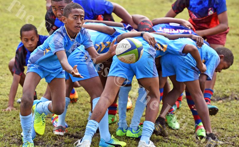 Ilaitia Rakuru of John Wesley Primary looks for support against Marist Suva Street primary in boys under 12 Suva Kaji rugby at Gospel grounds yesterday. Picture: RAMA
