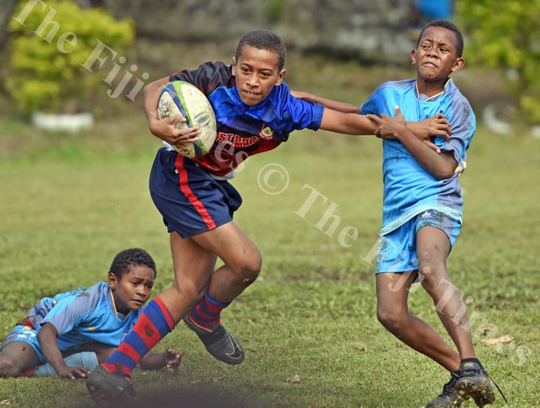Isoa Lakepa of Marist Suva Street primary attacks against John Wesley Primary in boys under 12 Suva Kaji rugby at Gospel grounds yesterday. Picture: RAMA