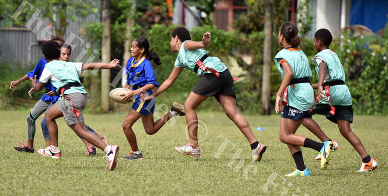 Action from Nausori Primary School and St John The Worker during the girls school Kaji rugby at Ratu Cakobau park ground 2 yesterday. Picture: RAMA