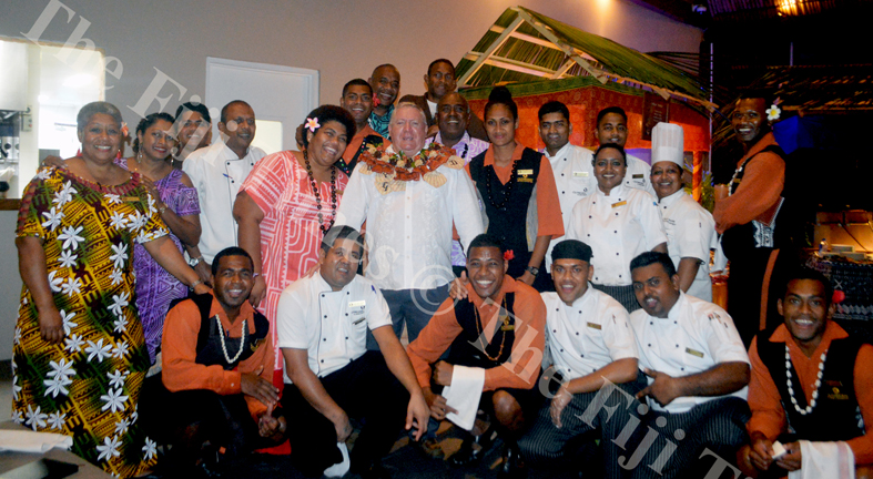 Outrigger Fiji Beach Resort General Manager Peter Hopgood (centre) surrounded by staff members during his farewell ceremony on Friday Night. Picture: SHAYAL DEVI