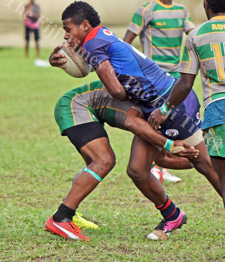 Joape Renato of John Wesley College attacks against Assembelies of God during the Southern Zone school rugby at Suva Grammar grounds yesterday. Picture: RAMA