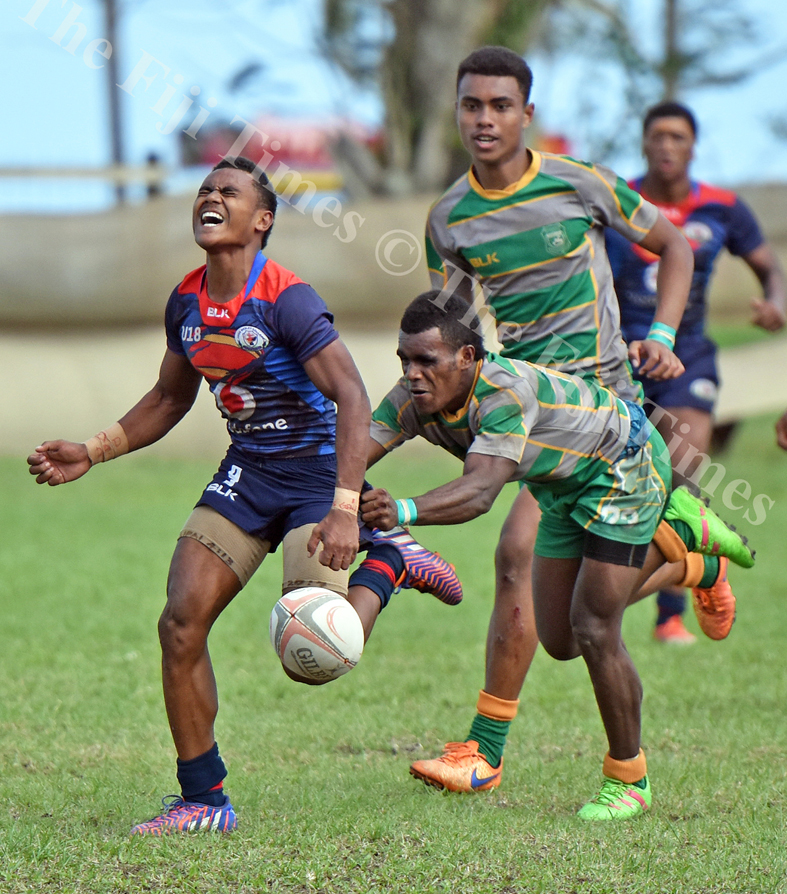 Ratu Kelevi Mawi of John Wesley College losses tha ball against Assembelies of God during the Southern Zone school rugby at Suva Grammar grounds yesterday. Picture: RAMA