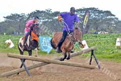 Horse owner and jockey Zinal Rahiman on his horse Don complete the last obstacle to win the Cross Country Race at the Sabeto Races in Nadi yesterday. Picture: REINAL CHAND
