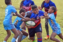 Elijah Koroitamana of Marist Suva Street primary attacks against John Wesley Primary in boys under 12 Suva Kaji rugby at Gospel grounds yesterday. Picture: RAMA