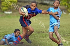 Isoa Lakepa of Marist Suva Street primary attacks against John Wesley Primary in boys under 12 Suva Kaji rugby at Gospel grounds yesterday. Picture: RAMA