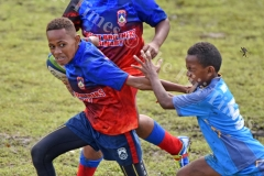 Makario Bale of Marist Suva Street primary attacks against John Wesley Primary in boys under 12 Suva Kaji rugby at Gospel grounds yesterday. Picture: RAMA