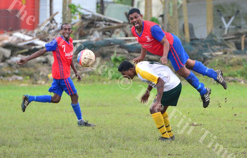 Ajesh Kumar of the Navua Sanatan football team heads the ball away during the final of the 59th Sanatan Vodafone IDC Masters match against Nadroga yesterday. Picture: JOVESA NAISUA
