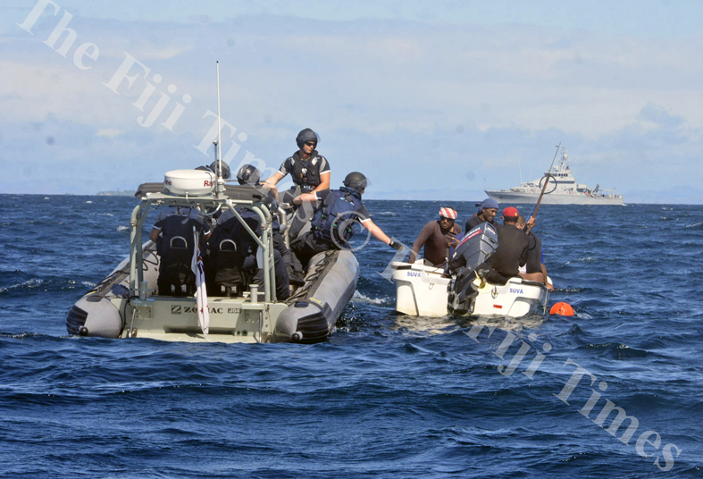 The patrol team speak to fishermen they encountered during a routine check in the Yasawas. Pictured in the background is the HMNZS Taupo. Picture: SHAYAL DEVI