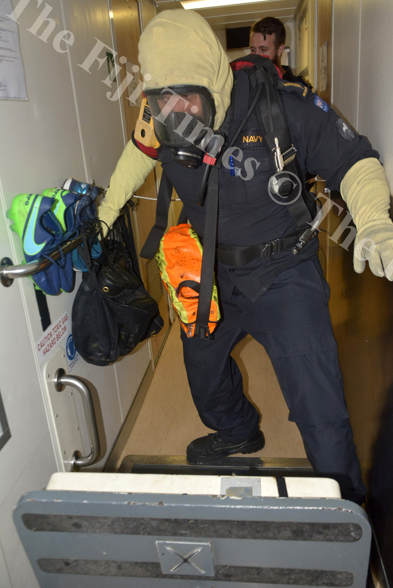 A crew member participates in a damage control training exercise on board the HMNZS Taupo. Picture: SHAYAL DEVI