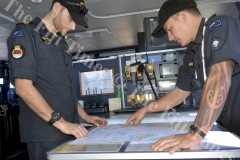 Lieutenant Benjamin Flight, left, studies a map of the patrol area with Sub Lieutenant Fletcher Slierendrecht. Picture: SHAYAL DEVI