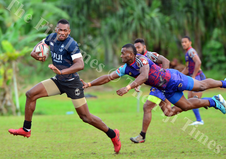 Fiji 7s forward Sevuloni Mocenacagi runs away from a Tabadamu player during their scrimmage session at Uprising grounds. Picture: JONACANI LALAKOBAU