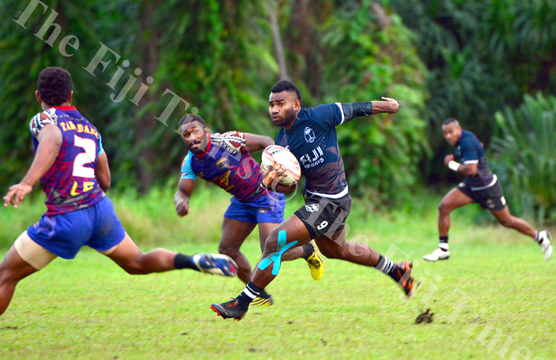 Fiji 7s captain Jerry Tuwai steps inside a Tabadamu player during their scrimmage session at the Uprising grounds. Picture: JONACANI LALAKOBAU