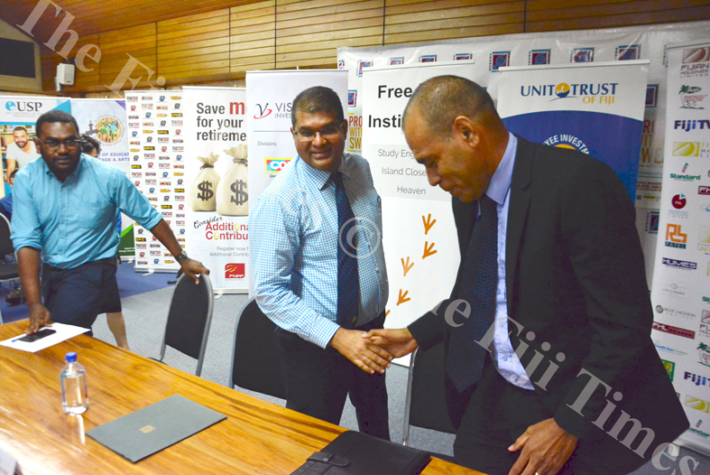 Reserve Bank of Fiji governor Ariff Ali (middle) shake hands with Sakiusa Bolaira (Uniti Trust of Fiji) while Roqiqi Korodrau (Free Bird Institute) looks on, at the launch of Capital Markets Week in Suva. Picture: ELIKI NUKUTABU