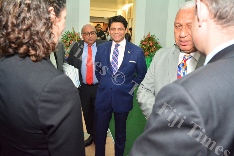Attorney-General and Minister for Economy, Public Enterprises, Civil Service & Communications Aiyaz Sayed Khaiyum (centre) was all smiles after delivering the 2018-2019 National Budget in parliament last night. Picture: JOVESA NAISUA