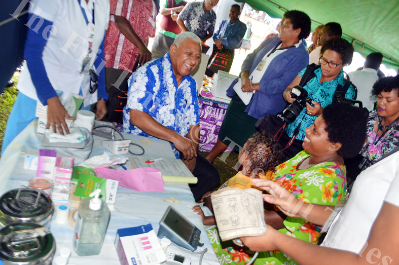 PM Voreqe Bainimarama receives a medical checkup with members of the public in Bua during the Government Road Show in Wainunu today.  Picture: LUKE RAWALAI
