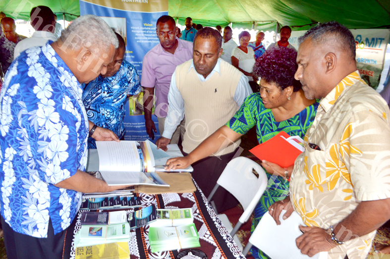 PM Voreqe Bainimarama tours the Ministry of Lands booth with Minister for Lands Faiyaz Koya during the Government a Road Show in Wainunu yesterday. Picture LUKE RAWALAI