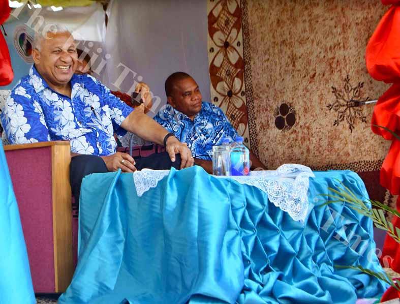 PM Voreqe Bainimarama enjoys a meke entertainment by the vanua o Bua during the Government Road Show in Wainunu yesterday. Picture LUKE RAWALAI