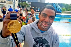 Fiji swimmer Epeli Rabua holds up his gold medal at the National Aquatic Centre in Suva yesterday. Picture: ELIKI NUKUTABU