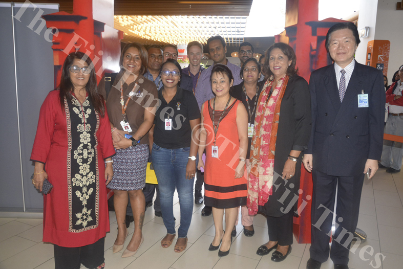 Japanese Ambassador Masahiro Omura (right) and Civil Aviation Authority of Fiji Chairperson Lailun Khan pose for a photo with the Fiji Airways staff during the inaugural flight to Japan yesterday. Picture: REINAL CHAND