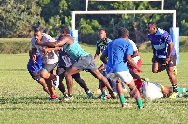 Filimoni Seru runs into heavy traffic during the Naitasiri rugby team training session at Bidesi Grounds in Laucala Bay, Suva on Tuesday, July 03, 2018. Picture: JONACANI LALAKOBAU