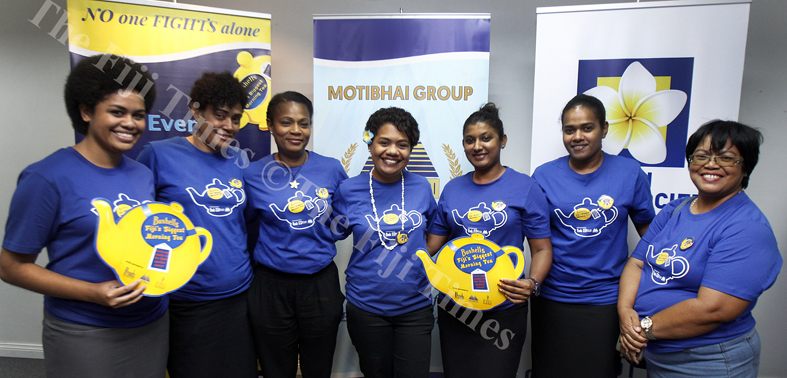 Volunteers of the Fiji Cancer Society with suvivors during the Bushell's Biggest morning tea at the Motibhai head office in Walu bay yesterday. Picture ATU RASEA