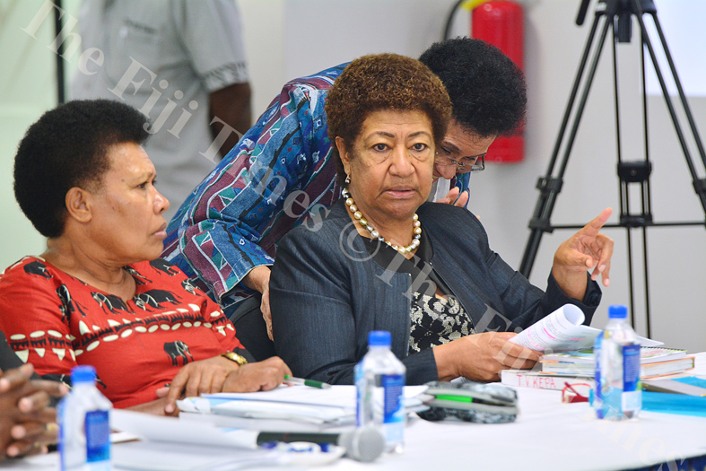 Opposition leader Ro Teimumu Kepa in discussions with opposition MP Mere Samisoni and government MP Jilila Kumar prior to the budget briefing yesterday. Picture: JOVESA NAISUA