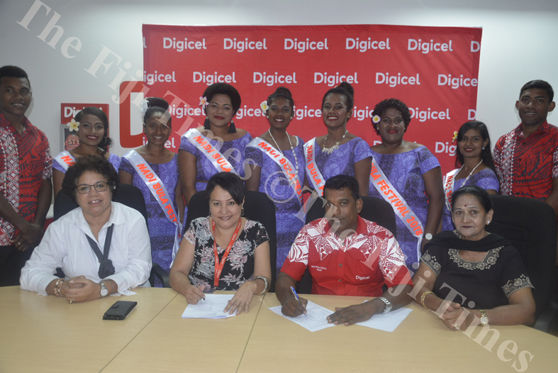 Nadi Bula Festival Committee President  Ravin Nadan (sitting 2nd from right) with trustee Sushila Ramesh (right) and Titilia Vuataki (far left) signs the sponsorship deal with Digicel's Regional Manager West Florence Eyre as the contestants look on. Picture: REINAL CHAND