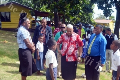 PM Voreqe Bainimarama speaks to a Galoa Primary School student who was part of the guard of honor formed performed during his tour of the school property yesterday. Picture LUKE RAWALAI