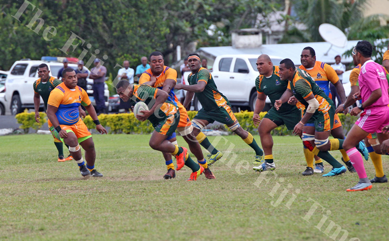 Seremaia Naureure of Police Southern on attack against the Police Headquarters defence during the Commissioner's Cup challenge at the Nasova grounds in Nasese, Suva on Wenesday, July 04, 2018. Picture: JONACANI LALAKOBAU