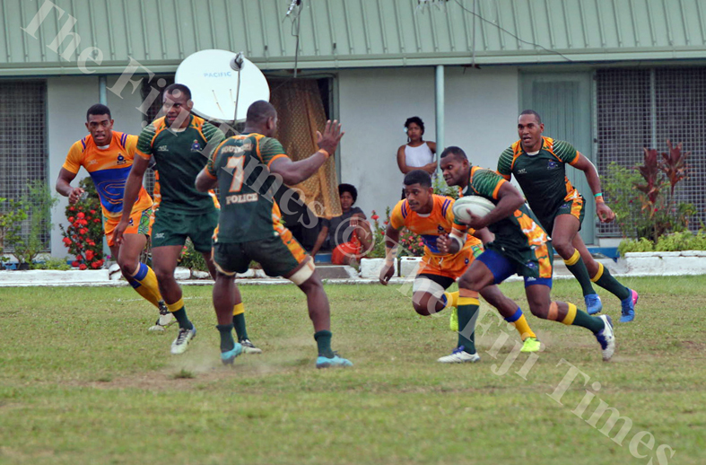 Josefa Bole of Police Southern on attack against the Police Headquarters defence during the Commissioner's Cup challenge at the Nasova grounds in Nasese, Suva on Wenesday, July 04, 2018. Picture: JONACANI LALAKOBAU