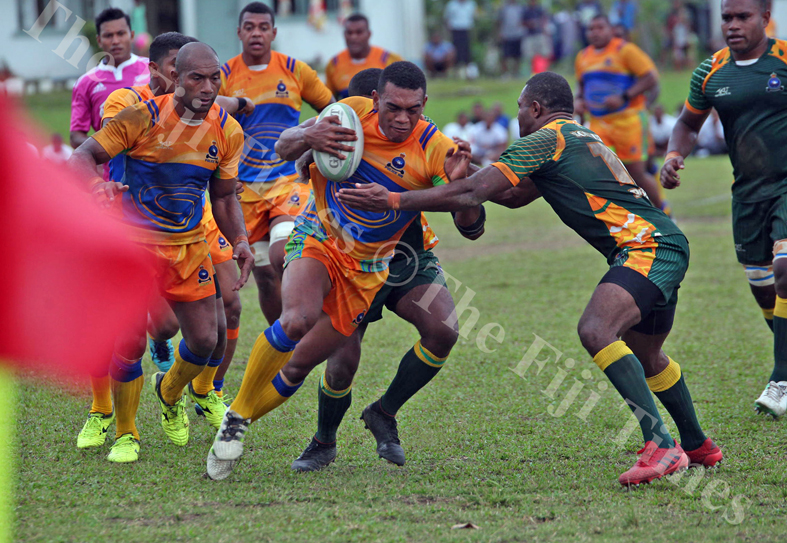 Epeli Misiamete of Police Headquarters tries to makes his way through the Police Southern defence during the Commissioner's Cup challenge at the Nasova grounds in Nasese, Suva on Wenesday, July 04, 2018. Picture: JONACANI LALAKOBAU