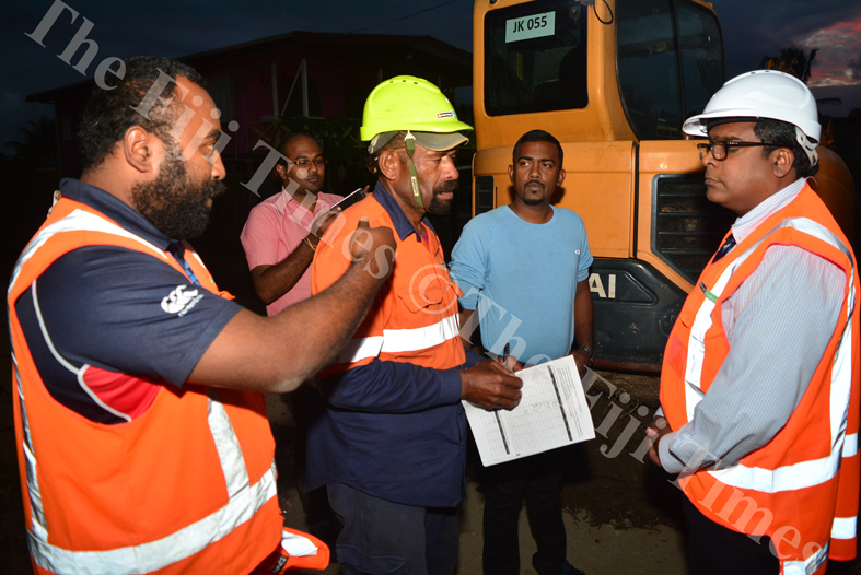 Fulton Hogan supervisor Suliasi Lesianavanua (left) breifs the Minister for Waterways Mahendra Reddy about the dredging works being carried out in Koronivia, Nausori. Picture: JOVESA NAISUA