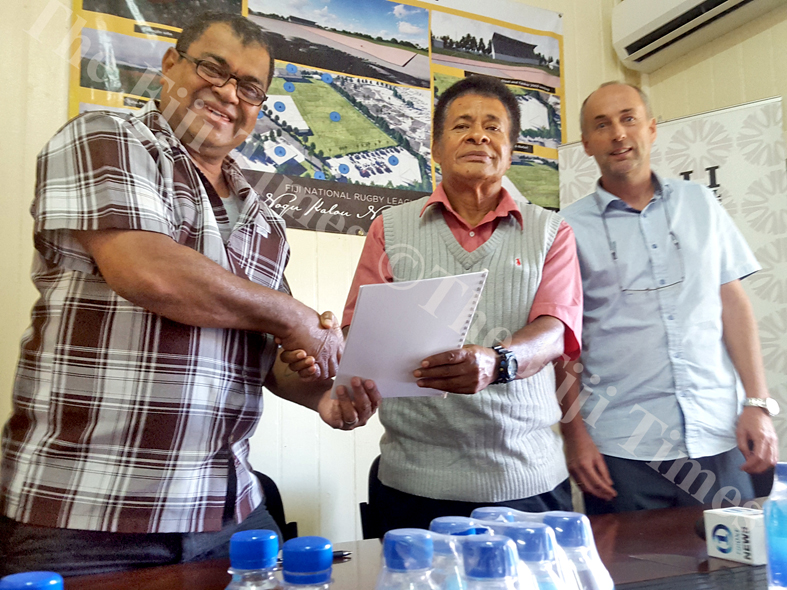 Fiji National Rugby League president Peni Musunamasi (left) shake hands with Mosese Kama (Nasinu Special Administrator) while CEO Lute Berends looks on, at the signing of the new FNRL grounds construction, in Suva. Picture: ELIKI NUKUTABU