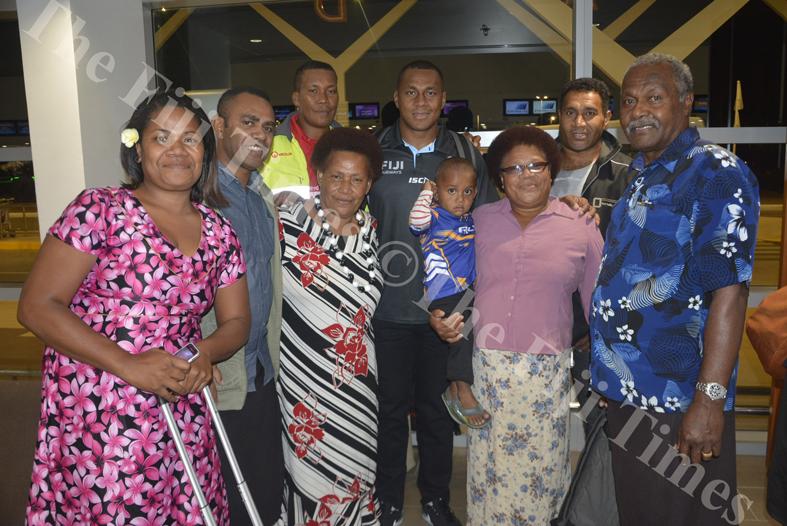 Fiji Airways 7s player Paula Dranisinikula with his family at the Nadi International Airport. Picture: REINAL CHAND