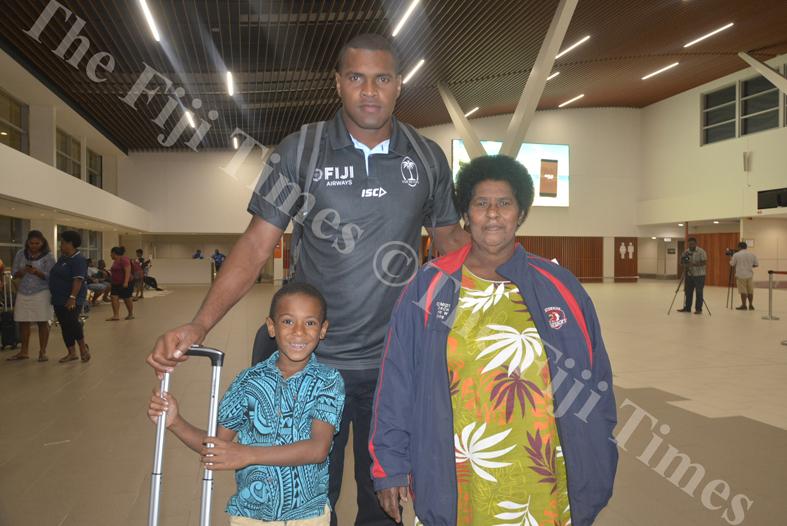 Fiji Airways 7s player Josua Vakurunabili with aunt Torika Driu and nephew Teresi Taliqa at Nadi International Airport. Picture: REINAL CHAND