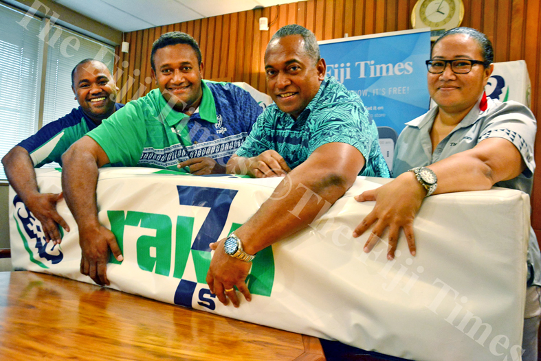 Raka 7s Apenisa Naitini (left) and Tournament director Rppate Kauvesi is joined by Fiji Times Editor Fred Wesley and Marketing Manager Annie Robinson during their signing in Suva. Picture: ELIKI NUKUTABU