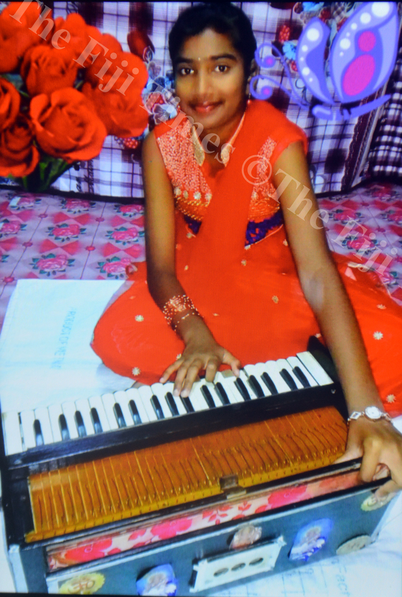 Ritika Mala Devi practises playing Harmonium at her home in Lautoka. Picture: SUPPLIED