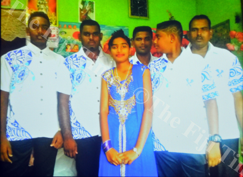 Ritika Mala Devi with her father Rajnesh Chand (right) and brothers Ritik Chand, Rishal Chand, Rahul Chand and Rahil Chand at her home in Lautoka. Picture: SUPPLIED