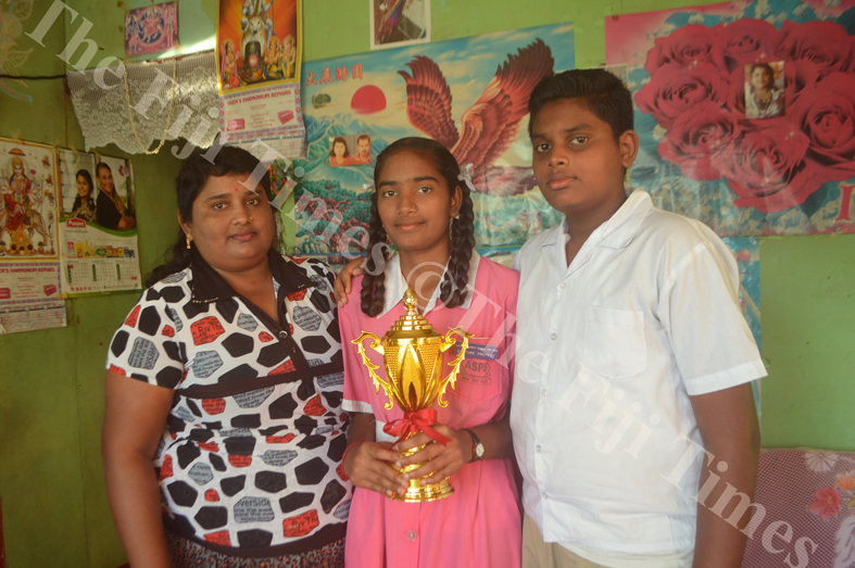 Ritika Mala Devi with her mother Malti Devi and twin brother Ritik Chand show her first award for participating at a kirtan competition in Lautoka. Picture: REINAL CHAND
