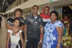 Fiji Airways 7s player player Vatemo Ravouvou bits farewell to his daughter Torika Ravouvou (left), cousin Epeli Biukimaleya (2nd from right) and aunts Viame Nakovesi (left) Senieni Qoro at the Nadi International Airport. Picture: REINAL CHAND