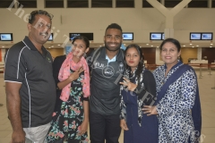 Fiji Airways 7s captain Jerry Tuwai pose for a photo with Riaz Mohammed (left), Raishah Raimah, Zahraa Zymah and Zeenat Shafil at the Nadi International Airport. Picture: REINAL CHAND