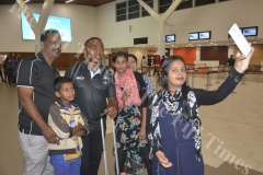 Zahraa Zymah with her family takes a selfie with Fiji Airways 7s player Waisea Nacuqu at the Nadi International Airport. Picture: REINAL CHAND