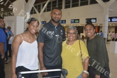 Fiji Airways 7s player Jasa Veremalua poses for a photo with fans Ana Ledua (left), Deborah Valentine and Nisi Ledua at the Nadi International Airport. Picture: REINAL CHAND