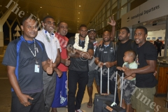 Fiji Airways 7s players Semi Kunatani and Amenoni Nasilasila with fans at the Nadi International Airport. Picture: REINAL CHAND