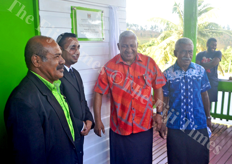 Prime Minister Voreqe Bainimarama in a light mood after unveiling the Legal Aid Commission office plaque in Nabouwalu yesterday. Picture: LUKE RAWALAI