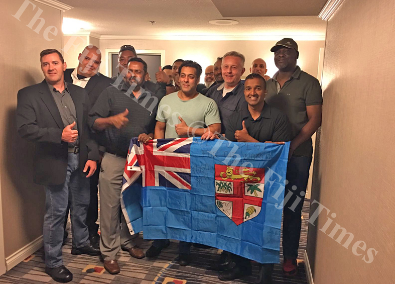 Salman Khan showing his support to the Fiji 7s for the World Cup. He is pictured here with members of the Metropolitan security company. Picture: SUPPLIED.